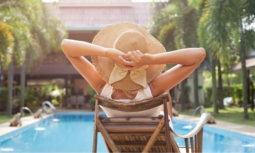 woman enjoying a clean pool deck and patio